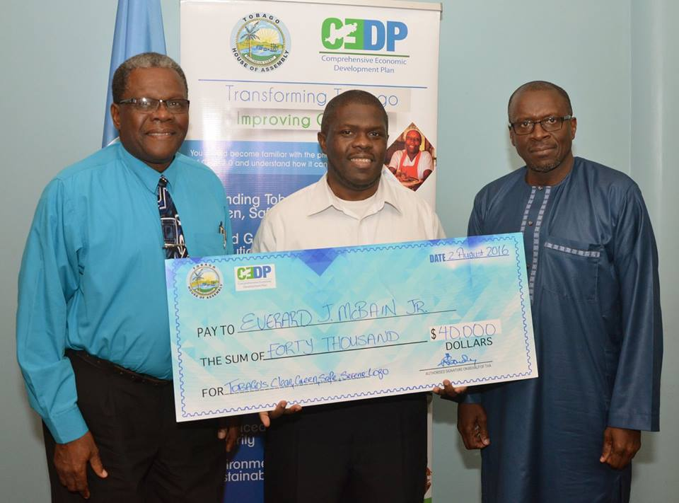 The prize giving ceremony for the winner of the Tobago branding contest. L-R: CEDP Coordinator, Dr. Elton Bobb; Everard J. McBain Jr., GemGfx; Tobago House of Assembly's Chief Administrator Raye Sandy.